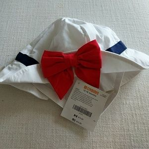 Hat with red bow